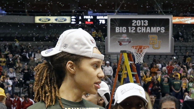 Baylor's Brittney Griner (42) and Kimetria Hayden, right, walk off the court holding the tournament trophy after their NCAA college basketball championship game against Iowa State in the Big 12 Conference tournament, Monday, March 11, 2013, in Dallas. Baylor won 75-47.(AP Photo/Tony Gutierrez)