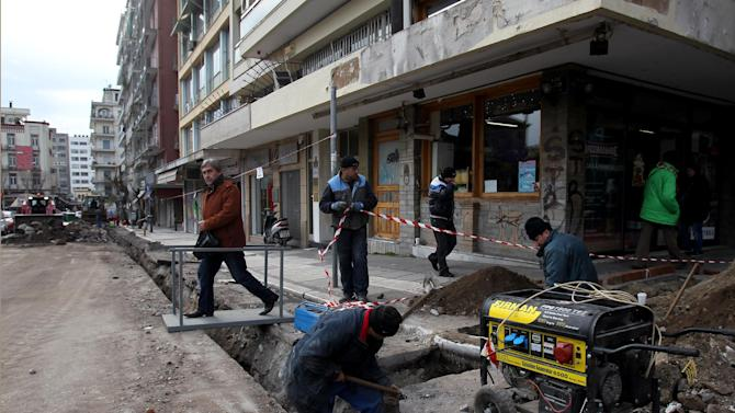Construction workers install natural gas pipes in the northern port city of Thessaloniki, Greece, on Wednesday, Jan. 9, 2013.  Greece has entered a sixth year of economic recession, and faces record high unemployment and homelessness rates as it struggles to tackle an acute financial crisis.(AP Photo/Nikolas Giakoumidis)