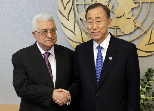 Palestinian President Mahmoud Abbas, left, shakes hands with United Nations Secretary-General Ban Ki-moon during the 66th session of the General Assembly, Monday, Sept. 19, 2011, at United Nations headquarters.  (AP Photo/Seth Wenig)