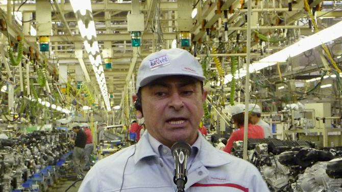 "In this May 20, 2011 photo, Nissan Motor Co. Chief Executive Carlos Ghosn speaks to reporters at its Iwaki plant three days after the plant damaged by the March 11 earthquake resumed its operation in Iwaki, Fukushima Prefecture. Nissan is back, one year after the March 11 earthquake and tsunami in northeastern Japan ground auto production to a halt, left giant cracks at a key factory and killed five employees and 17 family members. It's a story of surprising recovery that's playing out at other Japanese automakers, but particularly at Nissan. Ghosn called it ""miraculous"" Friday, March 9, 2012, ahead of the disaster's anniversary, crediting hard work from plant workers. (AP Photo/Kyodo News) JAPAN OUT, MANDATORY CREDIT, NO LICENSING IN CHINA, HONG KONG, JAPAN, SOUTH KOREA AND FRANCE"