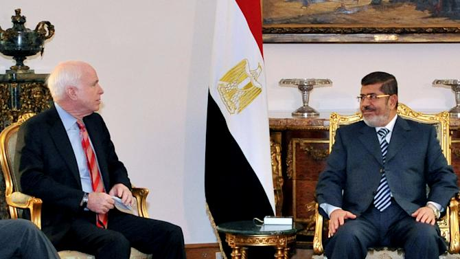 In this image released by the Egyptian Presidency, Egyptian President Mohammed Morsi, right, meets with Republican Sen. John McCain, at the Presidential Palace in Cairo, Egypt, Wednesday, Jan. 16, 2013. Morsi met with McCain in Cairo on Wednesday, for a visit expected to last three days. The meeting comes after the Obama administration on Tuesday gave a blistering review of remarks that the Egyptian President made almost three years ago about Jews and called for him to repudiate what it called unacceptable rhetoric. (AP Photo/Egyptian Presidency)