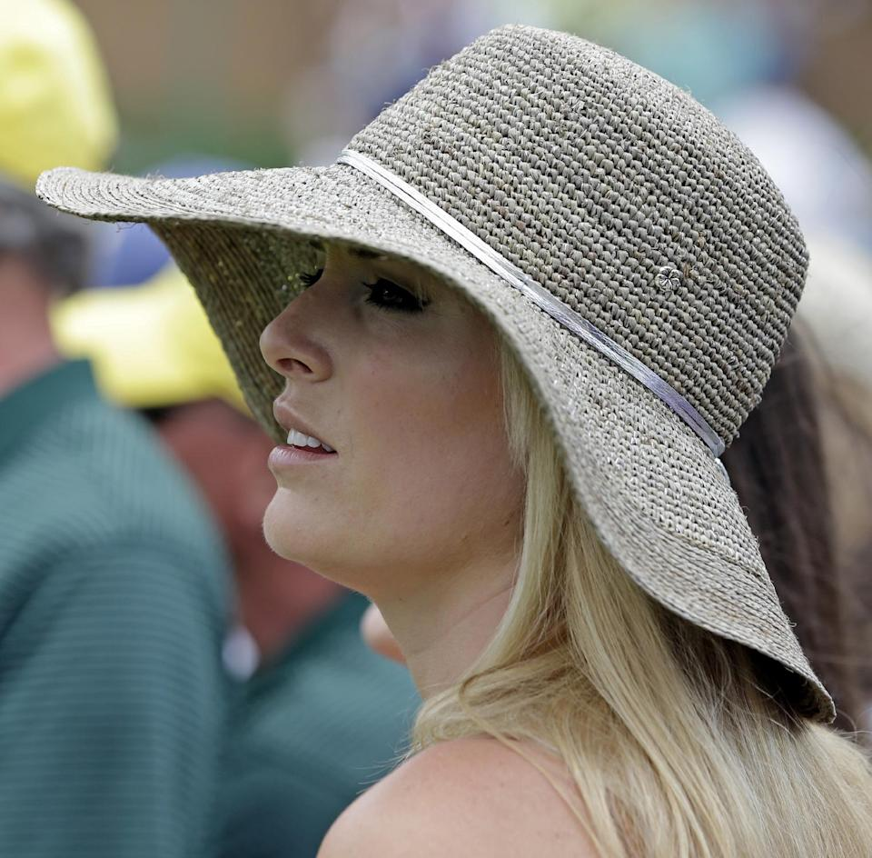 Skier Lindsey Vonn watches Tiger Woods on the ninth hole during the first round of the Masters golf tournament Thursday, April 11, 2013, in Augusta, Ga. (AP Photo/Darron Cummings)