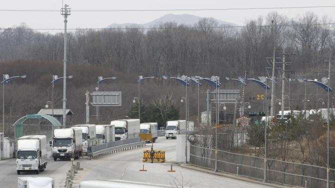 "South Korean vehicles return from a joint industrial complex of North Korean city of Kaesong at the customs, immigration and quarantine office, near the Demilitarized Zone (DMZ) of Panmunjom in Paju, north of Seoul, South Korea, Thursday, March 28, 2013. Raising tensions with South Korea yet again, North Korea said it cut the last military hotline with Seoul because there was no need for communications between the countries in a situation ""where a war may break out at any moment."" (AP Photo/Ahn Young-joon)"