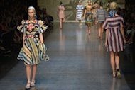 Models display creations as part of Dolce & Gabbana's spring-summer 2013 collection during women's fashion week in Milan. Dolce & Gabbana's fresh and innovative Sicilian-inspired collection starred intricate wicker bustiers, baroque-sculpture shoes and colourful beach prints