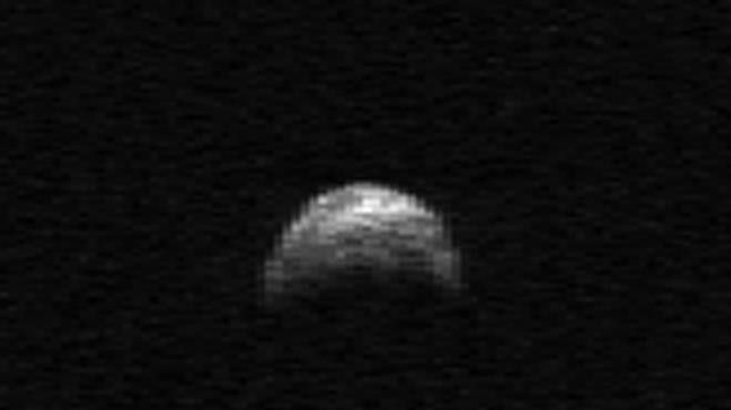 This image made from radar data taken in April 2010 by the Arecibo Radar Telescope in Puerto Rico and provided by NASA/Cornell/Arecibo shows asteroid 2005 YU55. The asteroid, bigger than an aircraft carrier, will dart between the Earth and moon Tuesday, Nov. 8, 2011 - the closest encounter by such a huge rock in 35 years. But scientists say not to worry. It won't hit. (AP Photo/NASA/Cornell/Arecibo)