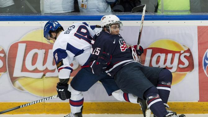 Team USA forward Vince Trocheck, right, gets taken out by Slovakia forward Andrej Bires, left, during first period IIHF World Junior Championships hockey action in Ufa, Russia on Monday, Dec. 31, 2012. (AP Photo/The Canadian Press, Nathan Denette)