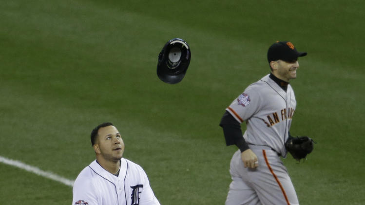 Detroit Tigers' Jhonny Peralta catches his helmet after tossing it in air after he popped out in sixth inning of Game 3 of baseball's World Series against the San Francisco Giants Saturday, Oct. 27, 2012, in Detroit (AP Photo/Patrick Semansky)