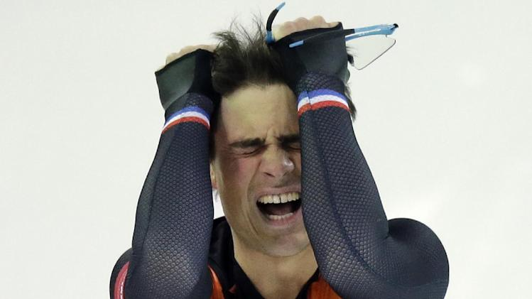 Silver medallist Jan Smeekens of the Netherlands pulls his hair after completing his second heat for the men's 500-meter speedskating race at the Adler Arena Skating Center at the 2014 Winter Olympics, Monday, Feb. 10, 2014, in Sochi, Russia