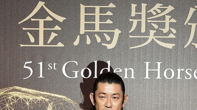 Japanese actor Masatoshi Nagase poses for photographers on the red carpet at the 51st Golden Horse Film Awards in Taipei