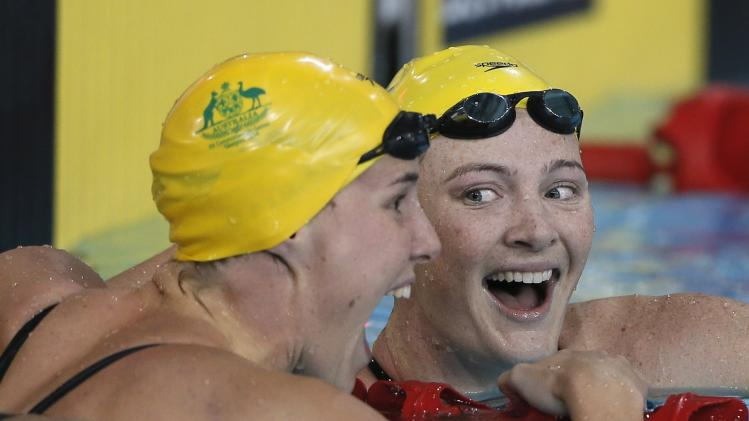Cate of Australia reacts next to compatriot Bronte after winning the women's 100m Freestyle final during the 2014 Commonwealth Games in Glasgow