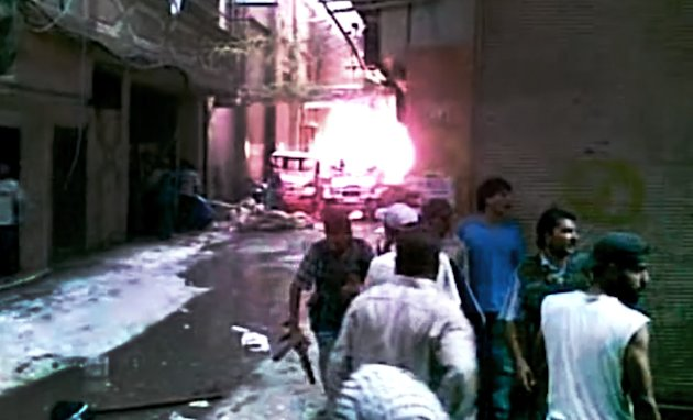 This image made from amateur video released by the Ugarit News and accessed Wednesday, July 18, 2012, purports to show Free Syrian Army soldiers during clashes with Syrian government forces at Tadamon Police Station in Damascus, Syria. Anti-regime activists say government forces are shelling a number of neighborhoods in and around the capital Damascus a day after a bomb killed three members of President Bashar Assad's inner circle. (AP Photo/Ugarit News via AP video) TV OUT, THE ASSOCIATED PRESS CANNOT INDEPENDENTLY VERIFY THE CONTENT, DATE, LOCATION OR AUTHENTICITY OF THIS MATERIAL