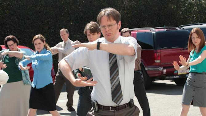 """This publicity image released by NBC shows the cast of """"The Office,"""" from left, Phyllis Smith as Phyllis Vance, Jenna Fischer as Pam Beesly Halpert, Jake Lacy as Pete, Rainn Wilson as Dwight Schrute, Ellie Kemper as Erin Hannon, right, in a scene from the series finale, airing Thursday, May 16, 2013 on NBC. (AP Photo/NBC, Chris Haston)"""