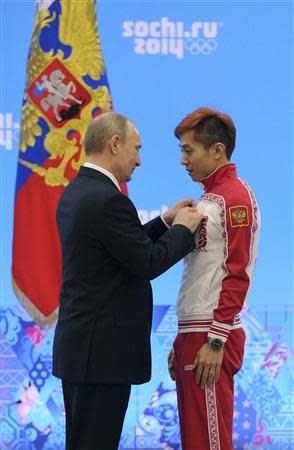 Russian President Putin awards Olympic 1000 meter short track old medallist Ahn at a ceremony in Sochi
