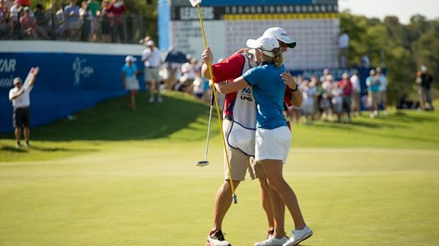 Stacy Lewis and caddie Travis Wilson celebrate Lewis' victory at the 2012 Navistar LPGA Classic (AFP)