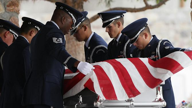 """CORRECTS DATE - Air Force servicemen remove the flag draped on the casket of actor Sherman Hemsley who was buried at the Fort Bliss National Cemetery with military honors, Wednesday, Nov. 21, 2012 in Fort Bliss, Texas. Friends and family remembered Hemsley at his funeral service in Texas by showing video clips of his best known role as George Jefferson on the TV sitcom """"The Jeffersons."""" He died in July but a fight over his estate has delayed his burial. (AP Photo/The El Paso Times, Mark Lambie)  EL DIARIO OUT; JUAREZ MEXICO OUT AND EL DIARIO DE EL PASO OUT"""
