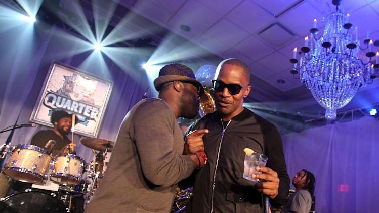 IMAGE DISTRIBUTED FOR PEPSI - Tariq Trotter from The Roots hugs Jamie Foxx on stage at the Pepsi 5th Quarter in the French Quarter Post Super Bowl Party, on Sunday, Feb. 3, 2013, in New Orleans. (Photo by Cheryl Gerber/Invision for Pepsi/AP Images)