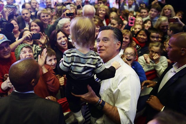 Republican presidential candidate, former Massachusetts Gov. Mitt Romney holds a child as he greets supporters at an election campaign rally at the Reno Event Center in Reno, Nev., Wednesday, Oct. 24,