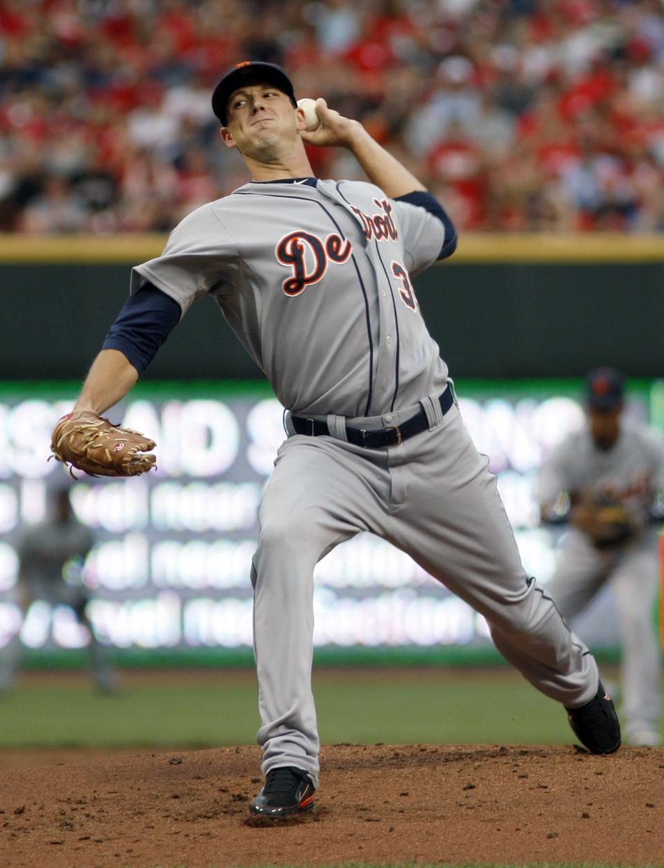 Detroit Tigers starting pitcher Drew Smyly throws against the Cincinnati Reds in the first inning of a baseball game, Sunday, June 10, 2012, in Cincinnati. (AP Photo/David Kohl)