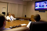 White House photograph shows US President Barack Obama and staff watching the vice presidential debate aboard Air Force One en route from Florida to Washington, October 11. Biden rained rhetorical punches on Republican Paul Ryan in a fiery debate, desperate to stem Democratic Party panic after Obama's lifeless display last week