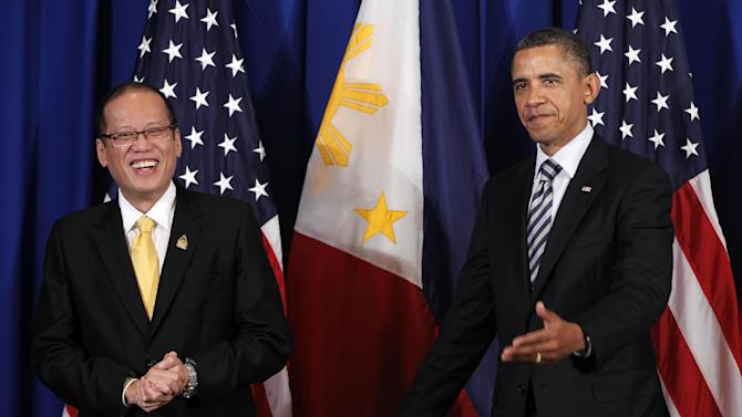U.S. President Barack Obama meets with Philippines President Benigno Aquino III on the sidelines of the ASEAN and East Asia summit in Nusa Dua, on the island of Bali, Indonesia, Friday, Nov. 18, 2011. (AP Photo/Charles Dharapak)