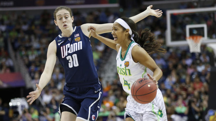 Notre Dame guard Skylar Diggins (4) drives against Connecticut forward Breanna Stewart (30) in the first half of the women's NCAA Final Four college basketball tournament semifinal, Sunday, April 7, 2013, in New Orleans. (AP Photo/Dave Martin)