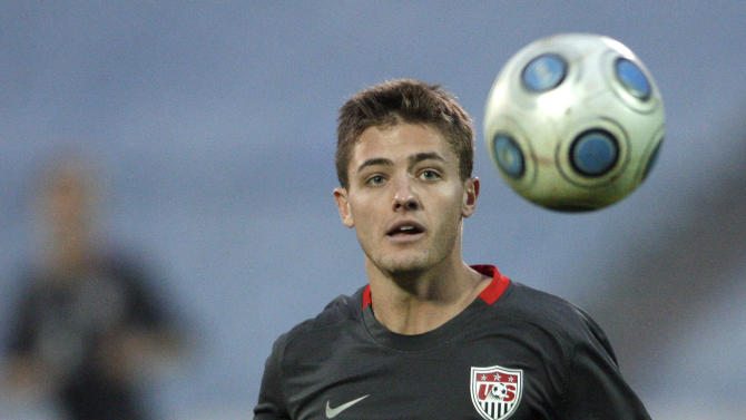 """FILE - In this Nov. 14, 2009, file photo, Robbie Rogers, of the United States, eyes the ball during the friendly soccer match against Slovakia in Bratislava, Slovakia. Former MLS and U.S. national team player Robbie Rogers says he is gay. In a post on his personal website, Rogers writes: """"Life is only complete when your loved ones know you. ... Try explaining to your loved ones after 25 years you are gay.""""(AP Photo/Petr David Josek, File)"""