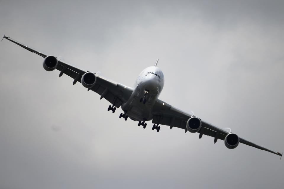 The Airbus A380 performs its demonstration flight during the 50th Paris Air Show at Le Bourget airport, north of Paris, Thursday, June 20, 2013.  (AP Photo/Francois Mori)