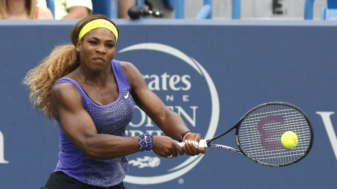 Serena Williams returns to Caroline Wozniacki, from Denmark, during a semifinal match at the Western & Southern Open tennis tournament, Saturday, Aug. 16, 2014, in Mason, Ohio. (AP Photo/David Kohl)