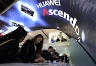 People check the Huawei Ascend P1S smartphone during the Mobile World Congress in Barcelona in February 2012. Chinese telecom giant Huawei is perplexed at its treatment in the West, with the United States fearful it is a Trojan horse for cyber warfare even as Europe eagerly courts its business