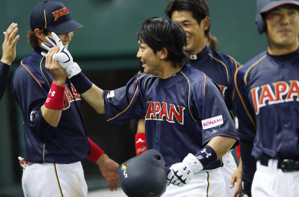 Japan's third baseman Nobuhiro Matsuda, center, celebrates with teammates after hitting an RBI single off Brazil's pitcher Kesley Kondo in the eighth inning of their World Baseball Classic first round game in Fukuoka, Japan, Saturday, March 2, 2013. (AP Photo/Koji Sasahara)