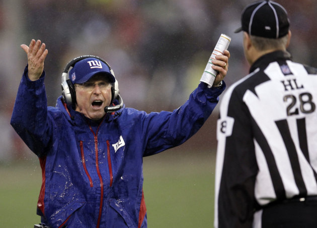 New York Giants head coach Tom Coughlin argues a call with head linesman Mark Hittner (28) during the first half of the NFC Championship NFL football game against the San Francisco 49ers Sunday, Jan.