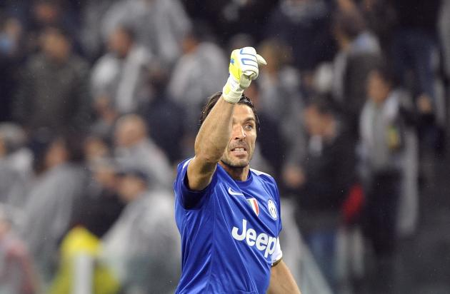 Juventus' goalkeeper Buffon reacts during their Italian Serie A soccer match against AC Milan in Turin