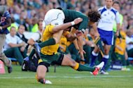 Australia's Anthony Fainga'a (bottom) tackles South Africa's Zane Kirchner during a Rugby Championship Test at Loftus Versfeld stadium in Pretoria. South Africa won 31-8