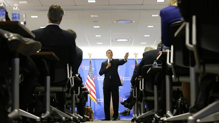 "President Barack Obama gestures as he speaks about the fiscal cliff at the Business Roundtable, an association of chief executive officers, in Washington, Wednesday, Dec. 5, 2012.  The president warned Republicans not to create another fight over the nation's debt ceiling, telling business leaders it's ""not a game that I will play."" (AP Photo/Charles Dharapak)"