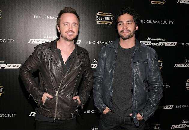 "Actors Aaron Paul, left, and Ramon Rodriguez, right, attend a screening of ""Need For Speed"" on Tuesday, March 11, 2014, in New York. (Photo by Andy Kropa/Invision/AP)"