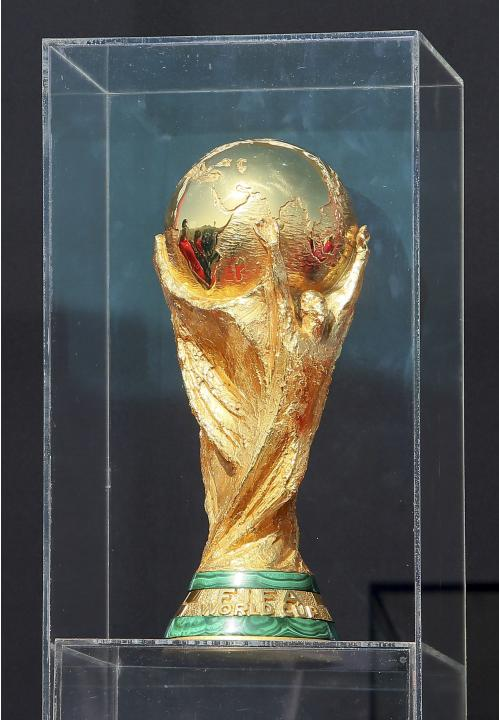 The FIFA World Cup trophy sits on display following its arrival on tour in Doha