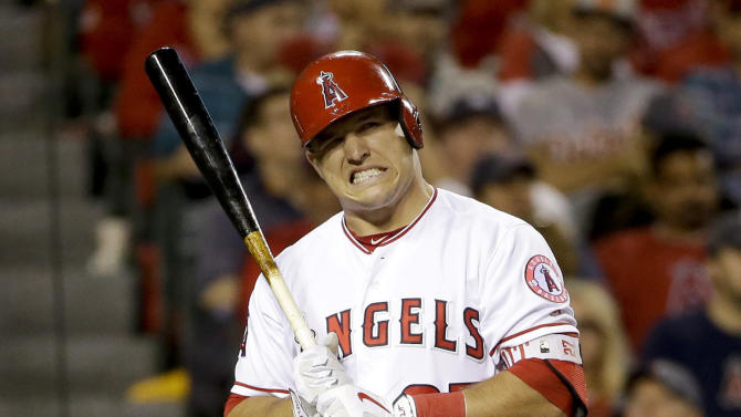 FILE - In this May 31, 2016, file photo, Los Angeles Angels' Mike Trout reacts to a called strike during the fourth inning of a baseball game against the Detroit Tigers in Anaheim, Calif. Less than two years after the Los Angeles Angels finished with the majors' best record, Mike Trout's team is on pace for the worst season in franchise history.  (AP Photo/Chris Carlson, FIle)