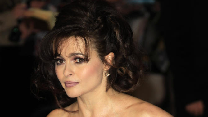 """FILE - In this Wednesday, Dec. 5, 2012 file photo, Helena Bonham Carter arrives on the red carpet for the World Premiere of """"Les Miserables"""" at a central London cinema in Leicester Square.  A report from Ancestry.com says Victor Hugo was a political colleague of a cousin of the 46-year-old actress. Carter stars as Madame Thenardier in the upcoming musical """"Les Miserables."""" (Photo by Joel Ryan/Invision/AP, File)"""