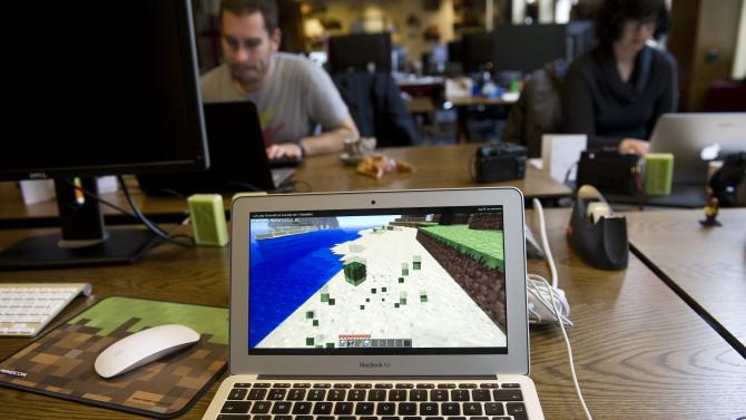 Employees of Swedish company Mojang, the creator of videogames like Minecraft, at work at their offices in Stockholm on November 10, 2012
