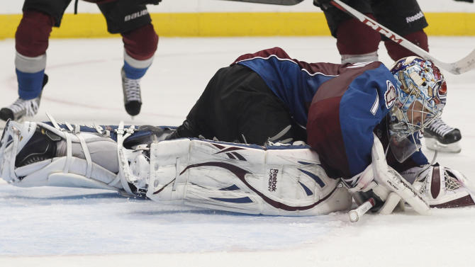 Colorado Avalanche goalie Semyon Varlamov, of Russia, drops on the ice to cover the puck after stopping a shot from the Chicago Blackhawks in the second period of an NHL hockey game in Denver, Friday, March 8, 2013. (AP Photo/David Zalubowski)