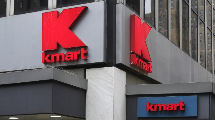 Pedestrians pass a Kmart location Tuesday, Dec. 27, 2011, in New York. Sears Holdings Corporation, the parent company of Sears and Kmart department stores, announced Tuesday morning that it will close 100 to 120 stores after a sluggish holiday season.(AP Photo/Frank Franklin II)