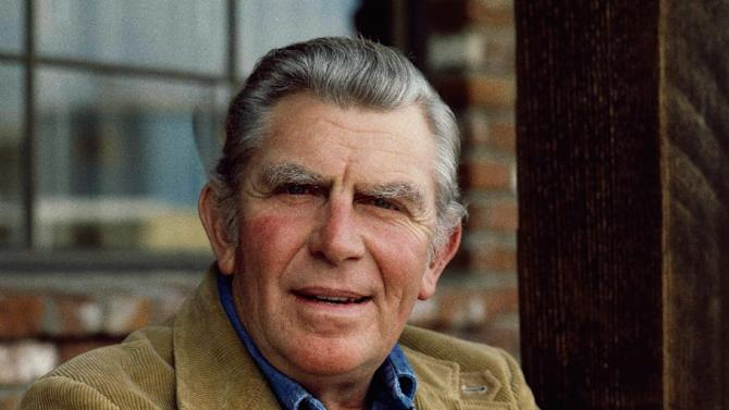 "FILE - This Jan. 1983 file photo shows actor Andy Griffith posing in Los Angeles to promote his upcoming CBS-TV film, ""Murder in Coweta County"". Andy Griffith led by example on the set of his television show, teaching a 6-year-old boy that true leadership requires not only confidence and hard work but also humility, Academy Award-winning film director Ron Howard said in recorded remarks Sunday during a Griffith tribute at the 23rd annual Mayberry Days celebration in Mount Airy, North Carolina. It's the first Mayberry Days held since Griffith, a native of Mount Airy, died July 3 at the age of 86 at his home in Manteo. The three-day event typically attracts 25,000 to 30,000 people.(AP Photo/Wally Fong, file)"