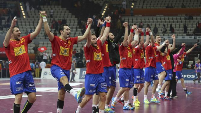 Spain's players celebrate after their round of 16 match against Tunisia in the 24th men's handball World Championship in Doha