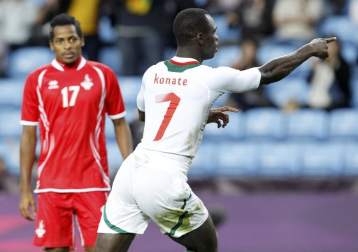 Senegal's Moussa Konate celebrates his goal near UAE's Mohamed Fawzi during their men's Group A football match at the London 2012 Olympic Games