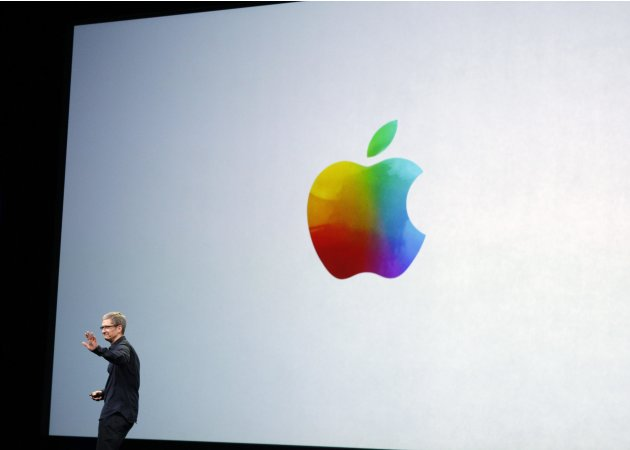 Apple CEO Tim Cook waves as he exits the stage at the conclusion of an Apple event introducing the new iPad in San Francisco