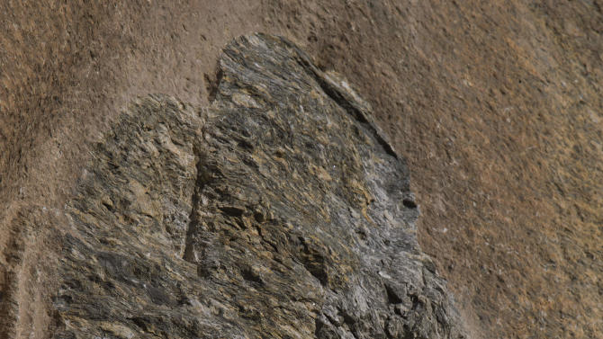 This May 24, 2012 photo, shows the face of a sculpture of the Buddha which was destroyed by Taliban fighters at Jahanabad, Pakistan in the Swat valley. When the militants detonated the face off the towering, 1,500-year-old rock carving in northwest Pakistan in fall 2007, it fell to an intrepid Italian archaeologist to come to the rescue. (AP Photo/B.K. Bangash)