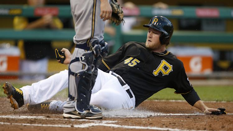 Pittsburgh Pirates starting pitcher Gerrit Cole scores from first on a double by Starling Marte in the third inning of the baseball game against the Milwaukee Brewers on Friday, June 28, 2013, in Pittsburgh. (AP Photo/Keith Srakocic)