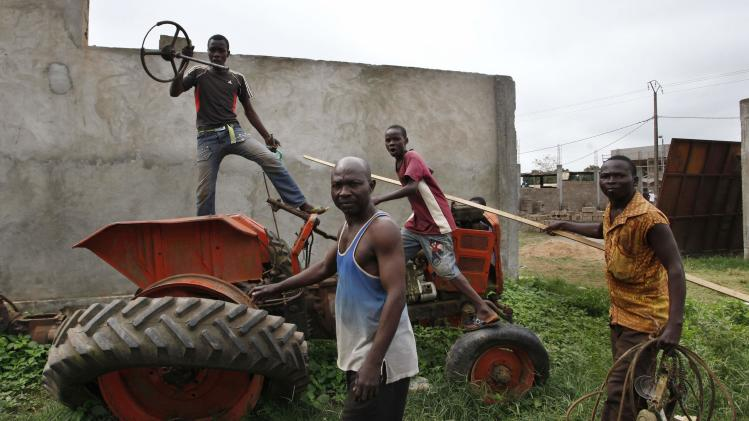 Christians remove parts from a tractor at a mosque compound in Bangui