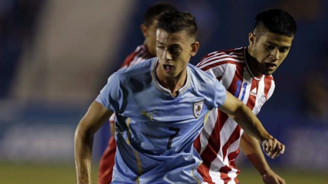 Brazil's Facundo Castro and Paraguay's Sergio Diaz fight for the ball during their final round South American Under-20 Championship soccer match in Montevideo