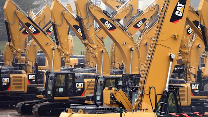 FILE - This Thursday, Feb. 28, 2013, file photo shows a parking lot at Caterpillar Belgium, in Gosselies, Belgium. Caterpillar Inc. reports quarterly financial results before the market opens on Monday, Jan. 27, 2014. (AP Photo/Yves Logghe, File)